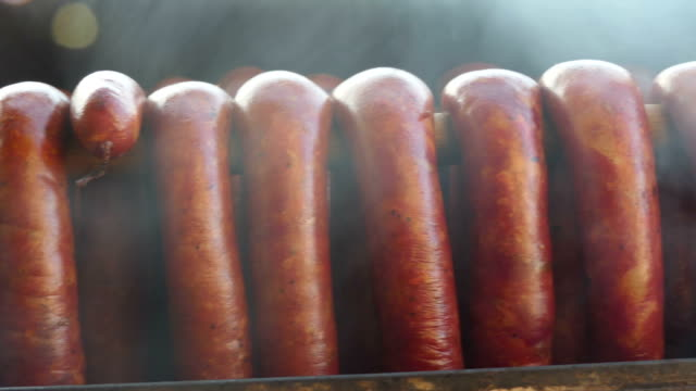 Close up pan shot of homemade smoked sausage during smoking process. Close up pan shot of homemade smoked sausage during smoking process. smokehouse stock videos & royalty-free footage