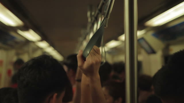 close up : people hands gripping handle bars in subway train video