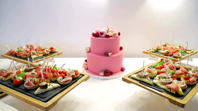 Close up Pink cake for lovers. Cake is decorated with a heart on Valentine day