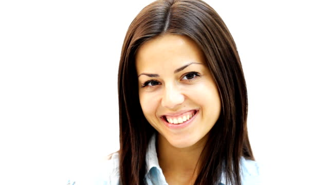Close up portrait of a beautiful smiling young woman. video