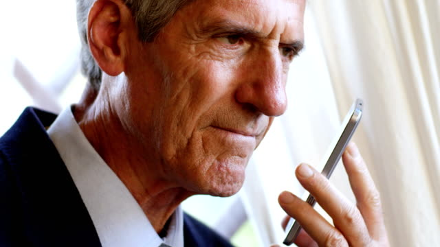 Close up portrait of Business man talking by phon with speakerphone video