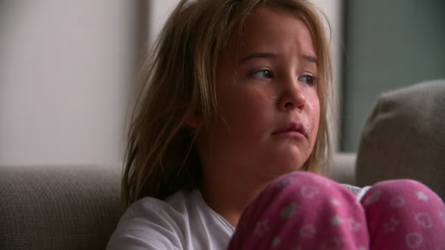 Close Up Portrait Of Crying Child Looking At Camera video