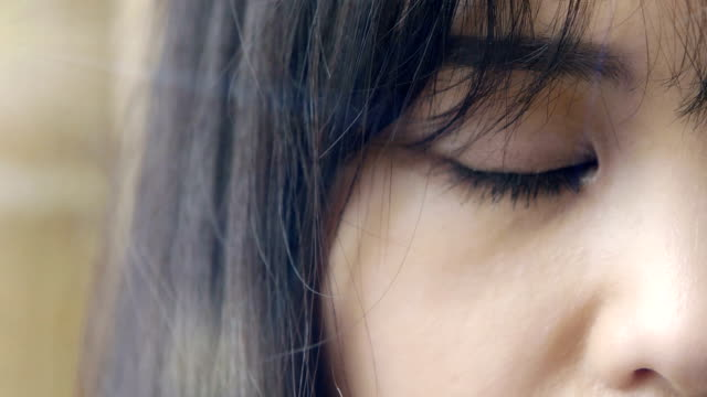 close up portrait on chinese young woman's eye video