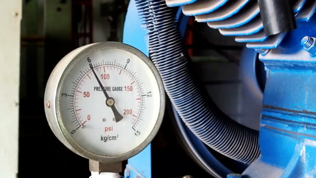 Close up pressure gauge with compressor working. video
