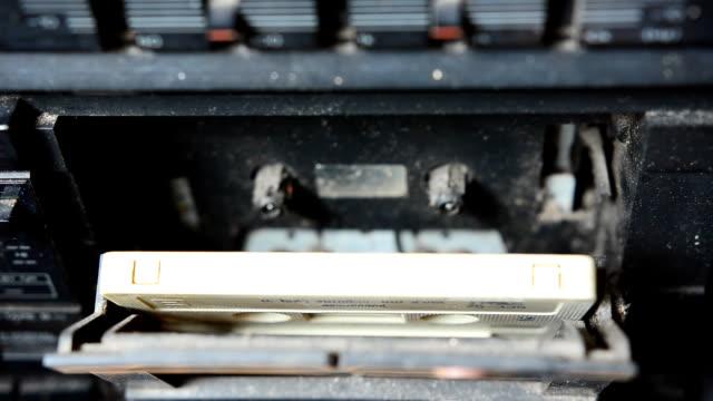 close up : put old cassette out a tape recorder video