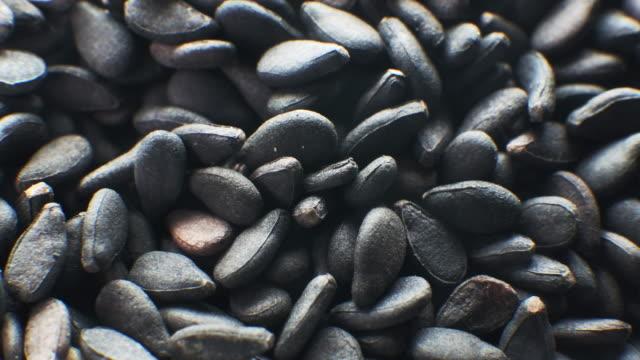 Close up rotate shot of Black sesame seeds healthy grain.