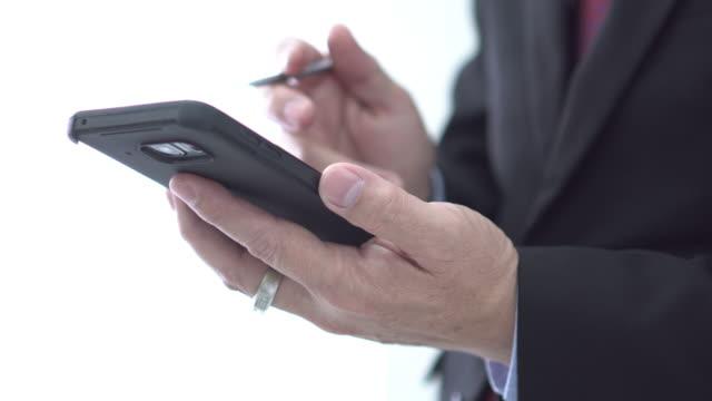 Close up senior businessman using digital pen and slide screen