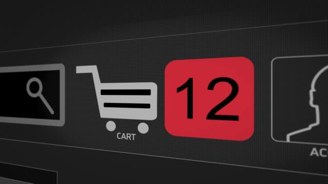 nahaufnahme aufnahme animation des warenkorb-symbol auf dem computer-bildschirm mit animierten zählzahlen hinzufügen online-ware auf shopping-webseite. der käufer macht einen kauf im laden. schwarze version - plus stock-videos und b-roll-filmmaterial