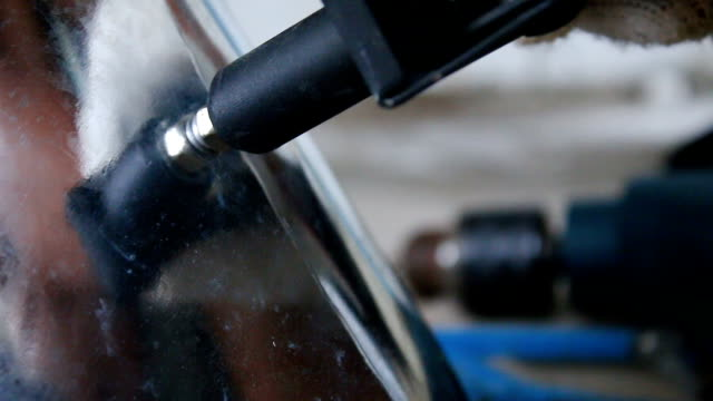 Close up shot hands of technician using rivet plier a sheet of alu zinc video