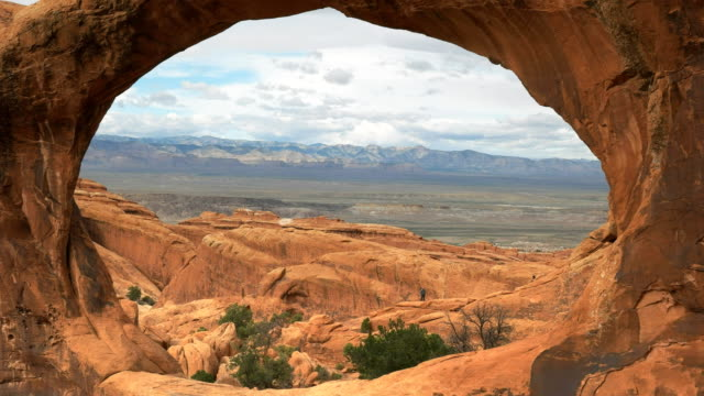 close up shot looking through double o arch in utah close up shot looking through double o arch at arches national park in utah, usa sandstone stock videos & royalty-free footage
