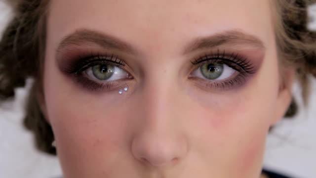 Close up shot. Make-up artist making creative make up with rhinestones video