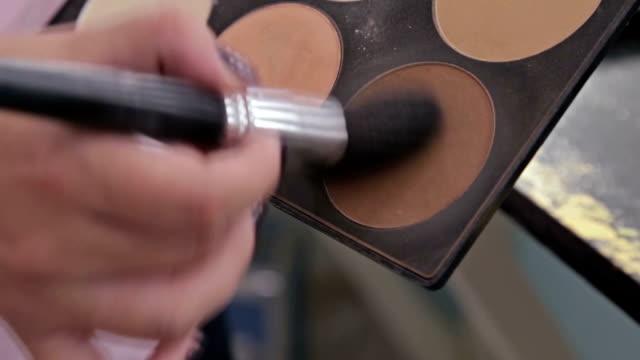 Close up shot. Make-up artist taking blusher from makeup palette video