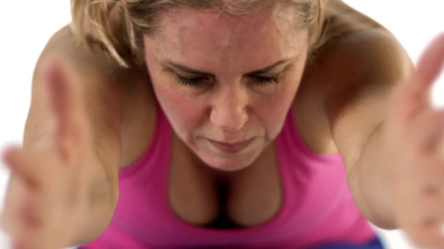 Close up shot of a focused white female doing yoga poses Close up shot of a focused white female doing yoga poses human joint stock videos & royalty-free footage