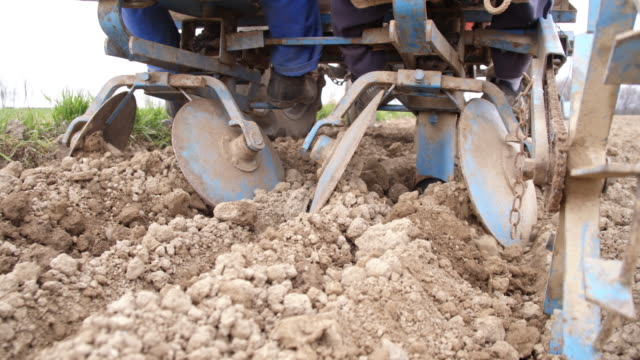 Close up shot of a potato planter Camera stabilization close up shot of a potato planter sowing potato on the field. Also available in 4K resolution. red potato stock videos & royalty-free footage