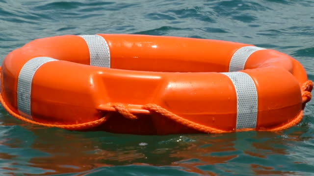 Close up shot of a red rescue buoy floating on the water surface video