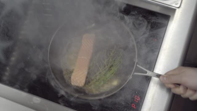 close up shot of a salmon filet being pan seared - abbrustolito video stock e b–roll