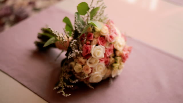 Close up shot of a wedding bouquet lying on a table video