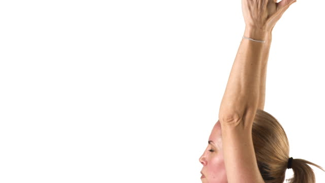 Close up shot of a white female doing yoga poses Close up shot of a white female doing yoga poses human joint stock videos & royalty-free footage