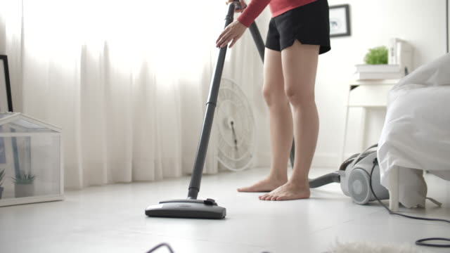 Close Up Shot of a Young Beautiful Woman in Casual Clothing Vacuum Cleaning on flooring at home Close Up Shot of a Young Beautiful Woman in Casual Clothing Vacuum Cleaning on flooring at home chores stock videos & royalty-free footage