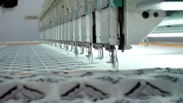 close up shot of an operational embroidery machine - cucire video stock e b–roll