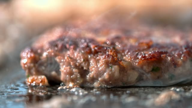 SLO MO Close up shot of frying a burger