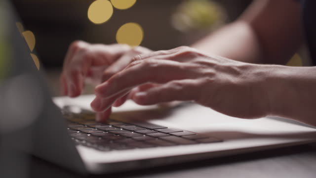 Close up shot of hands typing on a laptop at home office. WFH. Work from home.