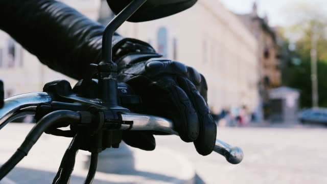 Close up shot of motorcyclist's hand on a bar video