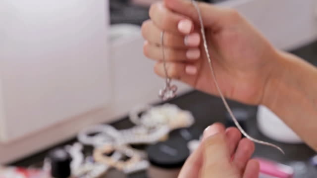 Close up shot of shiny pendant in woman's hands video