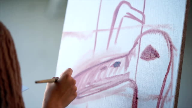 Close up shot of the canvas, on which the first strokes of the painting are applied video
