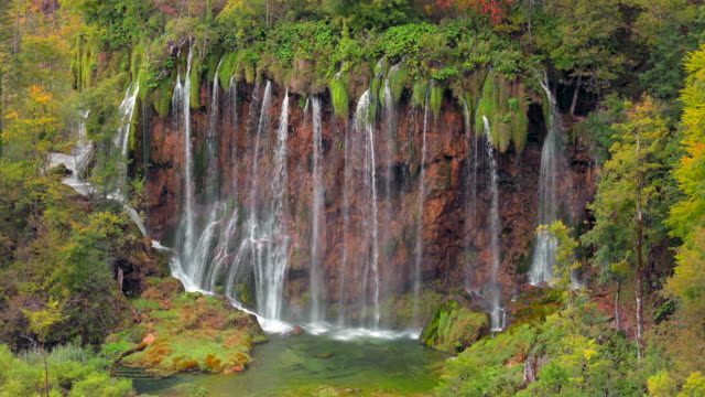 Close up shot of Waterfall inside a green forest, Plitvice Lakes National Park