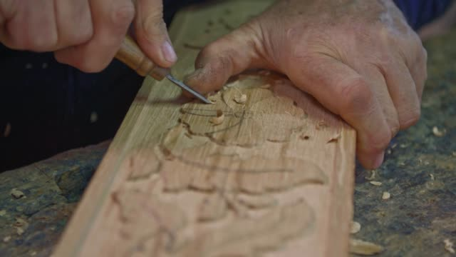 Close up shot of wood carver.