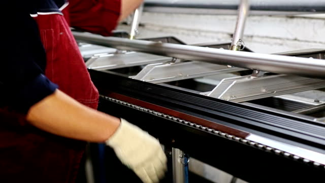 Close up shot operator bending metal sheet by sheet bending machine video