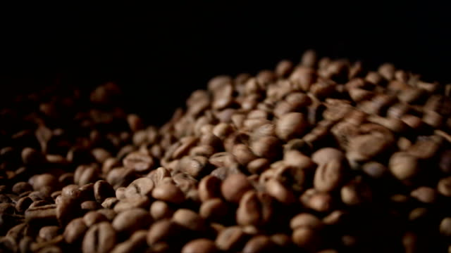 4K Close up shot roasting coffee bean by old method and vintage style dark and grain processed video