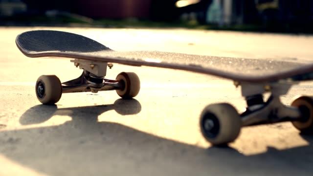 close up shot skateboard sun light