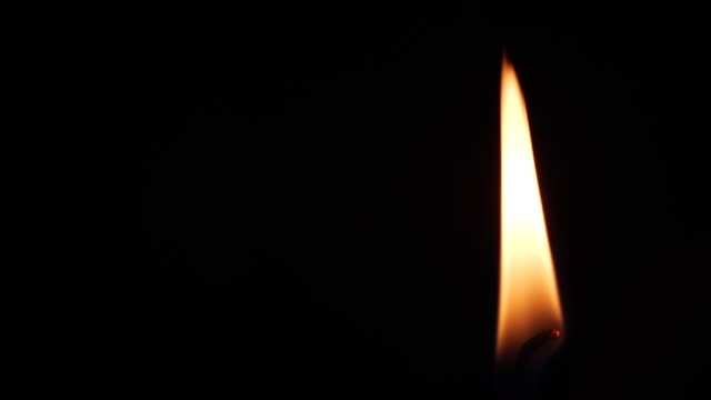 Close up single candle flame video