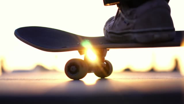 Close up skateboard in sunset light, Venice Beach skate park, Los Angeles, California
