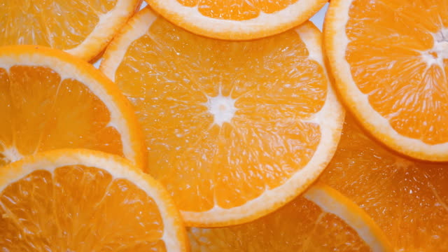 Close up sliced orange fruit  piece , rotation background