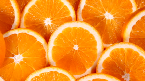Close up slices of orange group Close up slices of orange group fruit stock videos & royalty-free footage