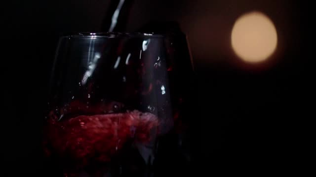 Close up, slow motion clip,Red wine is pouring into a glass. Close up, slow motion clip,Red wine is pouring into a glass. red wine stock videos & royalty-free footage