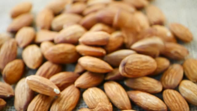 close up slow motion drop almond seed - noci video stock e b–roll