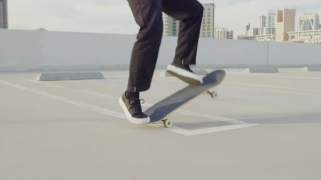 Close up slow motion of skateboarder doing extreme flip trick 4k slow motion shot of unrecognizable skateboarder doing extreme trick skateboarding stock videos & royalty-free footage