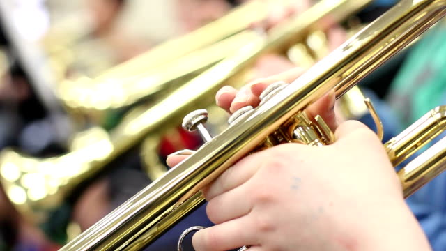 close up student playing trumpet - middle school stock videos & royalty-free footage