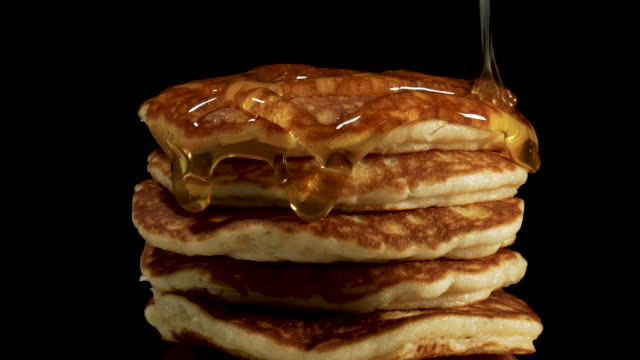 close up syrup flows down on a pile of pancakes - pancake video stock e b–roll
