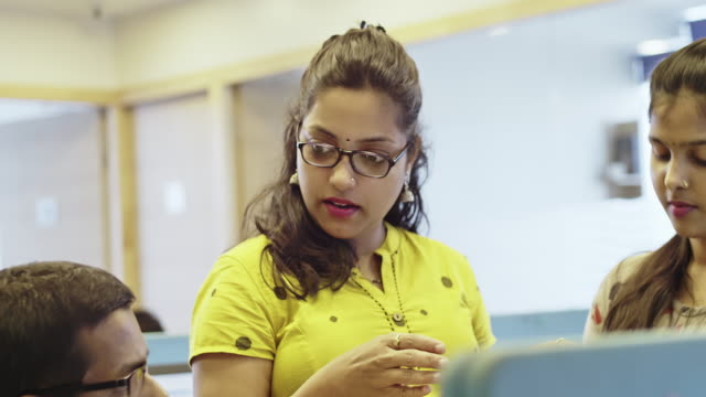 Close up Video of Female Office Manager Training New Staff about their CRM System Close up video of female Business Executive Training staff at office. indian culture stock videos & royalty-free footage
