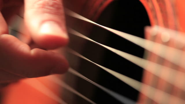 Close up video of guitarists hands macro video