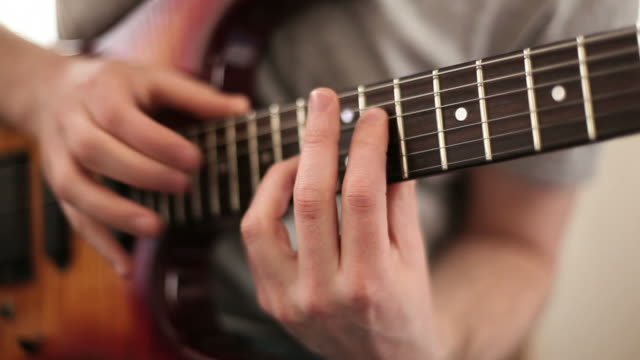 Close up video of guitarists hands video