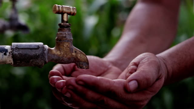 close up video shot of hands under tap water - bambine africa video stock e b–roll