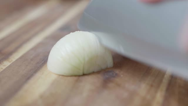 close up view fine chopping white onion
