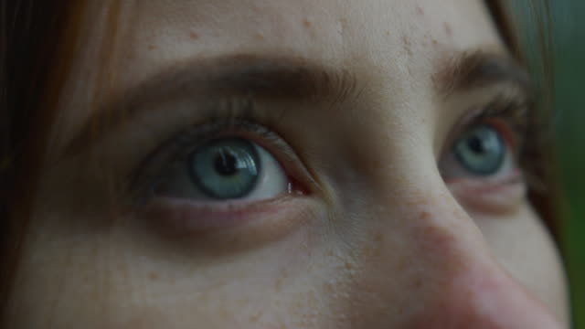 close up view of a girl with blue eyes - looking up stock videos & royalty-free footage