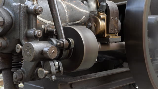 Close up view of a working vintage stationary combustion engine.